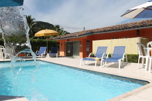 A piscina localizada em Pousada Porto Paraiso ou nos arredores