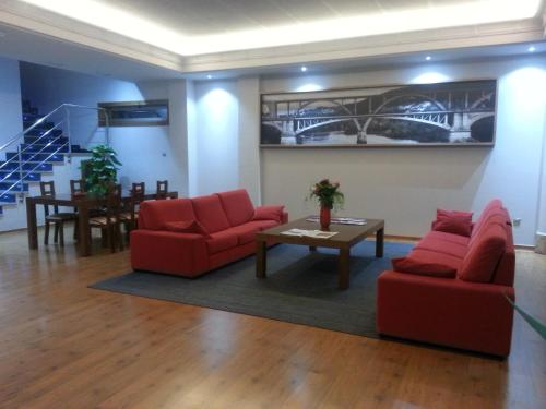 A seating area at Hotel San Cibrao
