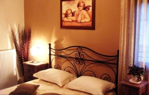 Ένα ή περισσότερα κρεβάτια σε δωμάτιο στο Garden Villa