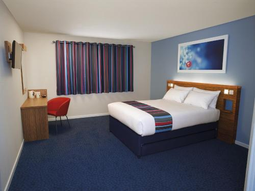 A bed or beds in a room at Travelodge Limerick Castletroy