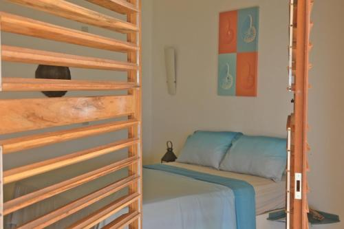 A bed or beds in a room at Casa Mar & Céu