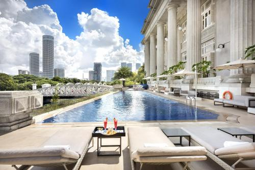 The swimming pool at or near The Fullerton Hotel Singapore (SG Clean, Staycation Approved)