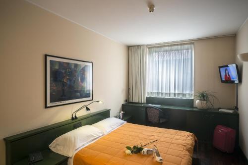 Letto o letti in una camera di Hotel Del Riale