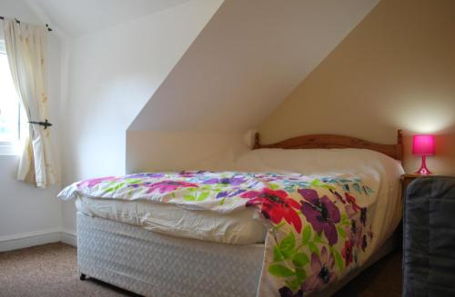 A bed or beds in a room at Clift Guest House