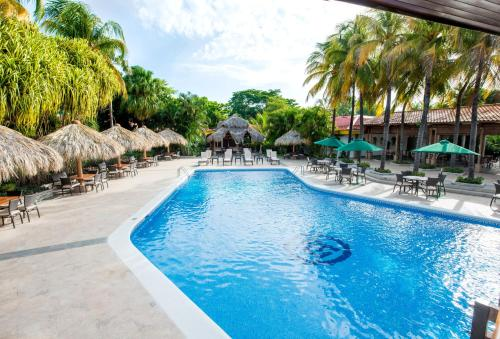 The swimming pool at or near Hotel Globales Camino Real Managua