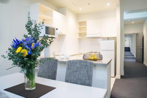 A kitchen or kitchenette at Collins Hotel