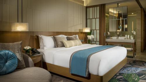 A bed or beds in a room at InterContinental Nha Trang