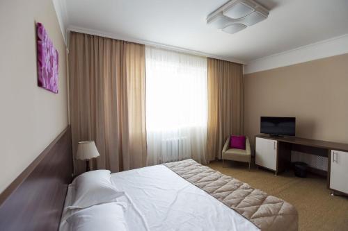 Кровать или кровати в номере Отель «Кел Инн»