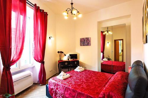 Letto o letti in una camera di MICLAD Colosseum Guest House