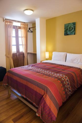 A bed or beds in a room at Kamma Guest House