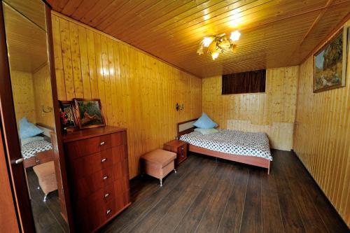 Кровать или кровати в номере Kamchatskiy Stil' Hostel