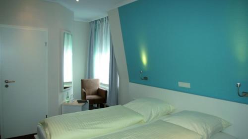 Ein Bett oder Betten in einem Zimmer der Unterkunft Gästehaus Küste