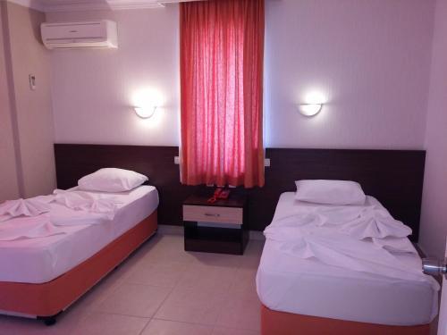 Säng eller sängar i ett rum på Ada-1 Apart Hotel