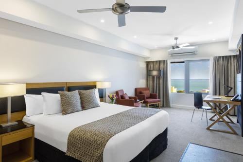 A bed or beds in a room at Oaks Darwin Elan Hotel