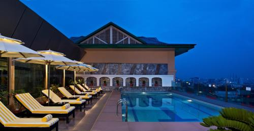 The swimming pool at or near Radisson Jaipur City Center