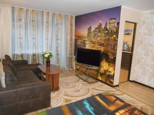 A television and/or entertainment center at Apartments at Chernyakhovskogo 18