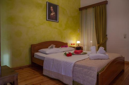 Ein Bett oder Betten in einem Zimmer der Unterkunft Philoxenia Apartments