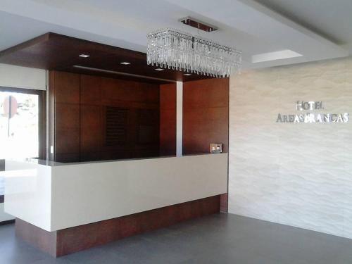 The lobby or reception area at Hotel Areias Brancas
