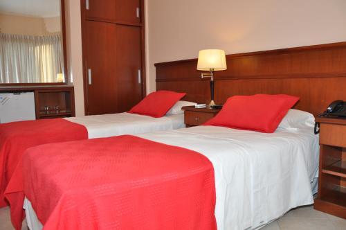 Кровать или кровати в номере RealNoa Hotel