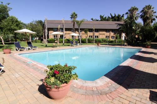 The swimming pool at or near Cresta Lodge Gaborone