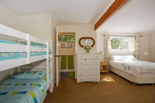 A bunk bed or bunk beds in a room at Torquay Retreats Aus - ThirtyOne Pride