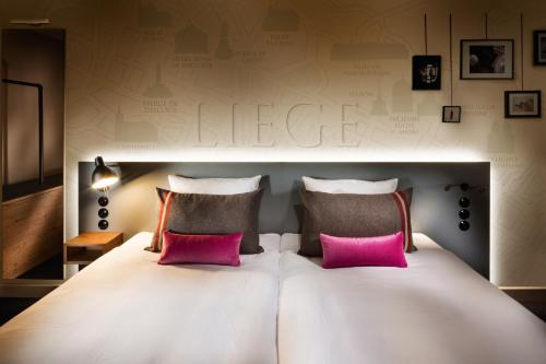 Ein Bett oder Betten in einem Zimmer der Unterkunft pentahotel Liège