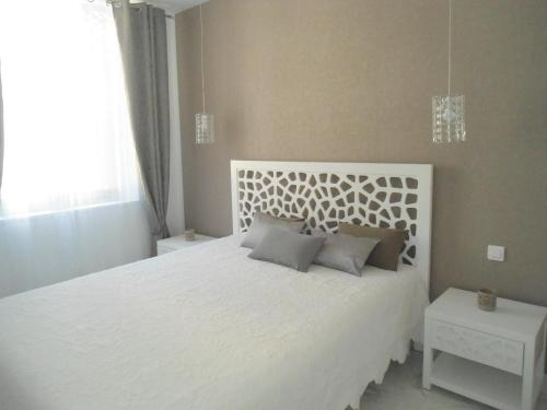 A bed or beds in a room at Carré d'Or