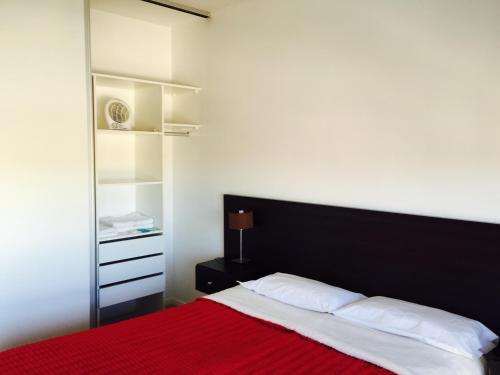 Una cama o camas en una habitación de Apart Hotel Cañuelas