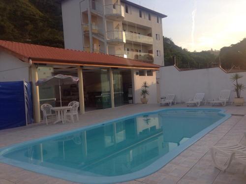 The swimming pool at or near Pousada Pescador