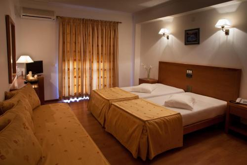 A bed or beds in a room at Hotel Santa Mafalda
