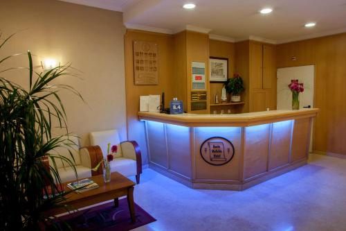 The lobby or reception area at Hotel Santa Mafalda