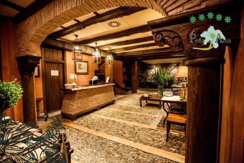 El vestíbulo o zona de recepción de Hotel Rural Peña Del Alba
