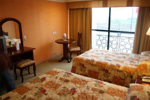 Cama o camas de una habitación en Grand Royal Tampico