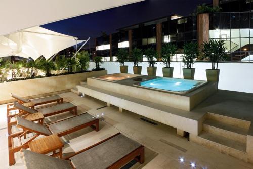 The swimming pool at or near Hotel Estelar Milla De Oro