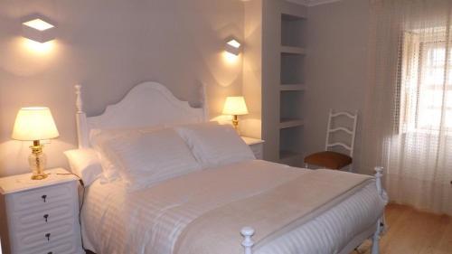 A bed or beds in a room at Casa Rural Santa Teresinha