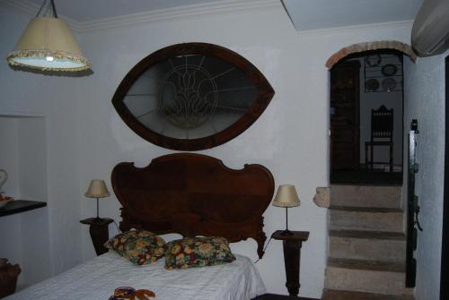 A bed or beds in a room at Casa da Adôa