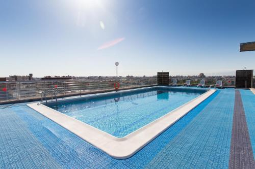The swimming pool at or near Expo Hotel Valencia