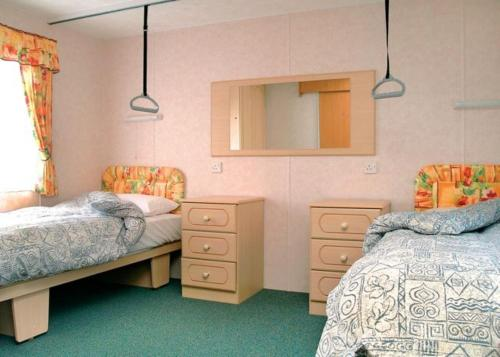 A bed or beds in a room at Riverside Holidays