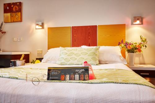 A bed or beds in a room at Auldington Hotel