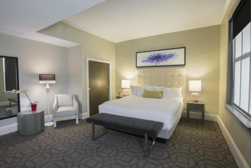 A bed or beds in a room at Magnolia Hotel Denver, a Tribute Portfolio Hotel