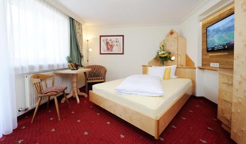 Ein Bett oder Betten in einem Zimmer der Unterkunft Hotel Jägerhof