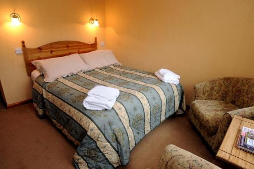 A bed or beds in a room at Abbey Court Guest House