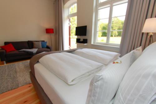 Ein Bett oder Betten in einem Zimmer der Unterkunft Ferienwohnungen Bahnhof Werder