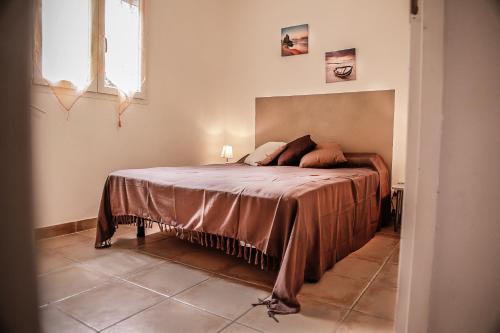 A bed or beds in a room at Perla Di Macchia