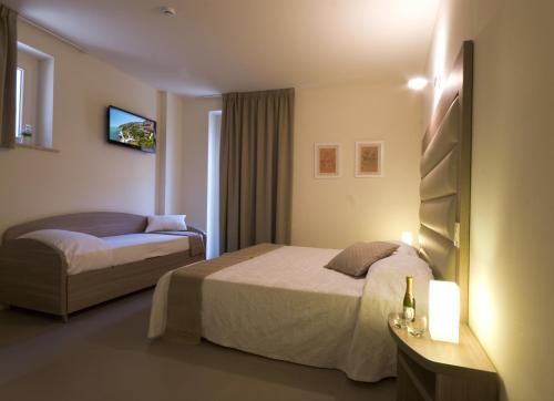 Letto o letti in una camera di Palazzo Ruschioni Boutique Hotel