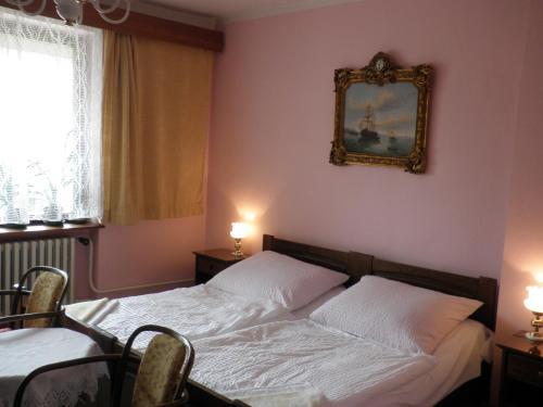 Ein Bett oder Betten in einem Zimmer der Unterkunft Pension Arcadia Prague