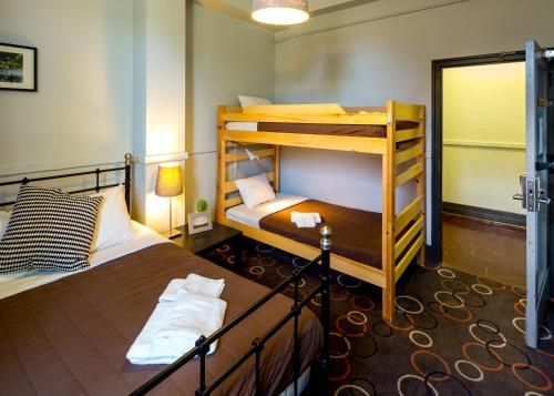 A bunk bed or bunk beds in a room at HI-Vancouver Jericho Beach