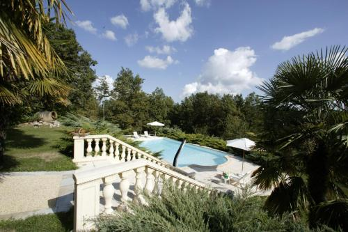 A view of the pool at Gîtes de La Palombière or nearby