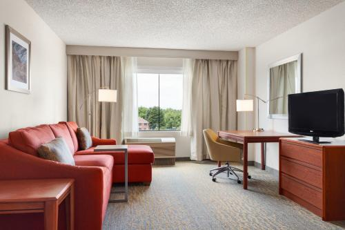A television and/or entertainment center at Hampton Inn & Suites Denver-Cherry Creek