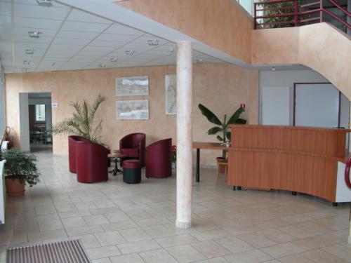 The lobby or reception area at Au Bon Sejour